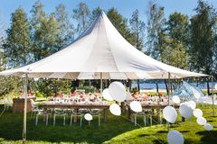 Wedding tent with large balls. Tables sets for wedding or another catered event dinner.  royalty free stock photo