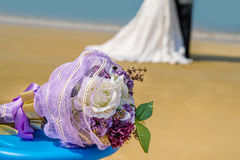 Wedding theme  with  bouquet on the ocean beach Royalty Free Stock Photography