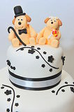 Wedding theme fondant cake figurines - doggies bride and groom Stock Photo