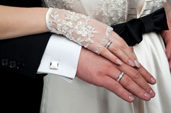 Wedding theme. Hands of the newlyweds together. Royalty Free Stock Photos
