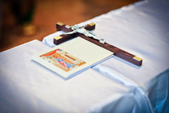 Wedding theme with religious book and wooden cross Stock Image