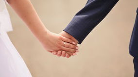 Wedding theme. Together. A young couple holding hands. stock video footage