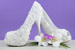 Wedding theme white floral bridal shoes Stock Photography