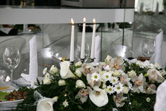 Wedding three burning candles on a holiday table Royalty Free Stock Photography