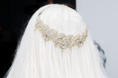 Wedding tiara diadem on the head of the bride head with blond ha royalty free stock photo