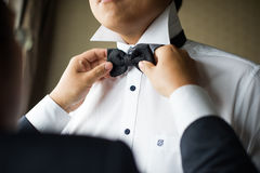 Wedding Tie. A wedding is the best man for the groom to wear a bow tie closeup Royalty Free Stock Images