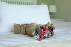 Wedding Tie over a white Bed royalty free stock photos