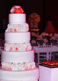 Wedding tier cake decorated with roses. Wedding cake, close-up. Beautiful flowers decoration for wedding cake Royalty Free Stock Images