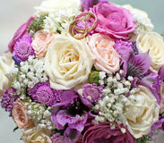 Wedding time. Wedding bouquet with two rings Stock Images