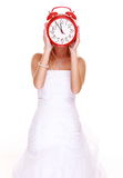 Wedding Time. Portrait bride with clock covering her face. Royalty Free Stock Photography