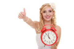Wedding. Time to get married. Bride with alarm clock. Stock Image