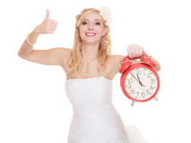 Wedding. Time to get married. Bride with alarm clock. Royalty Free Stock Images