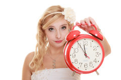 Wedding. Time to get married. Bride with alarm clock. Stock Photo