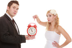 Wedding. Time to get married. Bride groom with clock. Royalty Free Stock Image