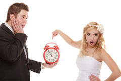 Wedding. Time to get married. Bride groom with clock. Stock Photography