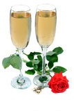 Wedding Toast. Two champagne glasses with a Red Rose Royalty Free Stock Image