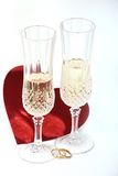 Wedding Toast. Pair of glasses with wedding rings and heart for toast Royalty Free Stock Image