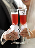 Wedding toast. Groom and bride get a toast Stock Photo