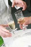 Wedding toast. Preparing for the toast during a wedding reception Stock Photography