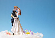 Wedding Topper. A wedding cake topper on top of the newlyweds dessert stock photo