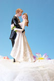 Wedding Topper. A wedding cake topper on top of the newlyweds dessert royalty free stock photos