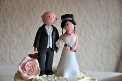 Wedding topper. Bride & Groom wedding cake topper royalty free stock images