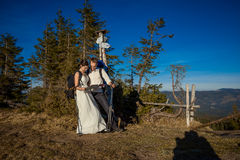 Wedding tourist couple look into the map. Honeymoon in mountains Stock Image