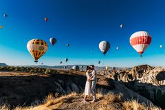 Wedding travel. Honeymoon trip. Couple in love among balloons. A guy proposes to a girl. Couple in love in Cappadocia. Couple in stock image