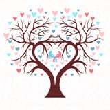 The wedding tree in the shape of a heart with two birds  Stock Images