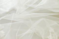 Wedding tulle or chiffon background. Ivory wedding tulle or chiffon background Royalty Free Stock Image