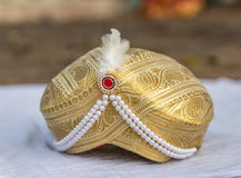 Wedding turban of an Indian groom. A turban is worn by Hindu Indian grooms as an accessory with sherwani Royalty Free Stock Image