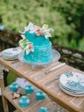 Wedding turquoise cake with flowers and gifts. Wedding banquet stock images