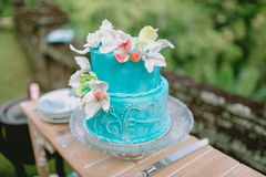 Wedding turquoise cake with flowers and gifts. Wedding banquet. Wedding turquoise cake with flowers and gifts stock images
