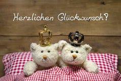 Wedding - two beige teddy bears lying in bed. Stock Photo