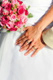 Wedding two hands. With wedding dress Stock Photography