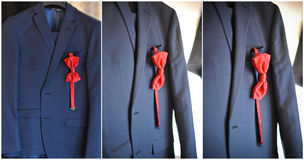 Wedding ultramarine suit and red bow. Formal groom suit with red bow-tie. Elegant blue groom's suit close up with bow tie Royalty Free Stock Image