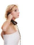 Wedding unhappy woman bride talking on phone. Royalty Free Stock Image