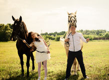 Wedding of unusual couple happy near horses Stock Image