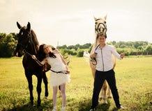 Wedding of unusual couple happy near horses Stock Image