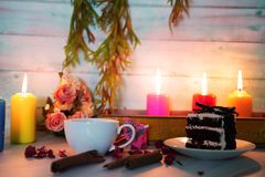 Wedding and valentine cake in candle light. Valentine cake and coffee in romantic candle lights royalty free stock photography