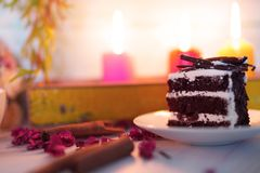 Wedding and valentine cake in candle light. Valentine cake and coffee in romantic candle lights stock image