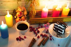 Wedding and valentine cake in candle light. Valentine cake and coffee in romantic candle lights stock photography