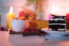 Wedding and valentine cake in candle light. Valentine cake and coffee in romantic candle lights royalty free stock photo