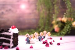 Wedding and valentine cake. Valentine and wedding cake chocolate with wedding dolls royalty free stock photos