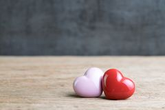 Wedding or Valentines background, red and pink hearts on wooden royalty free stock photography