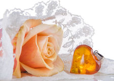 Wedding veil and amber heart Royalty Free Stock Photo