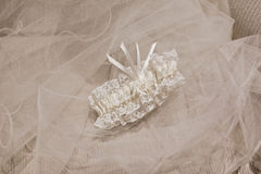 Wedding veil and a garter Royalty Free Stock Photography