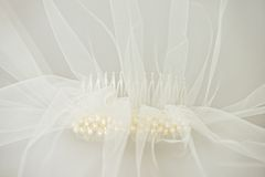 Wedding veil with a pearl comb. Ivory bridal wedding veil with a pearl comb under the veil Stock Photography