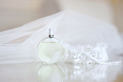 Wedding veil, perfume and a garter Stock Photo