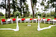 Wedding venue. Seating arrangement decorated with flowers at a wedding ceremony outdoors Stock Photos